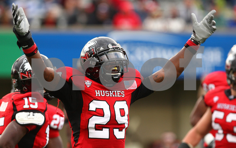 Kyle Bursaw – kbursaw@shawmedia.com<br /> <br /> Northern Illinois linebacker Jordan Delegal (29) pumps up the crowd during the third quarter of the game against Cal Poly at Huskie Stadium in DeKalb, Ill. on Saturday, Sept. 24, 2011.