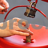 Kyle Bursaw – kbursaw@shawmedia.com<br /> <br /> A woman puts paper money into the Salvation Army red kettle before adding a few coins in the entrance of Schnuck's in DeKalb, Ill. on Thursday, Dec. 15, 2011.