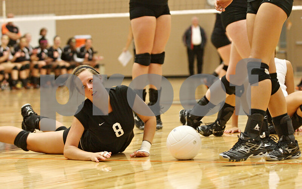 Rob Winner – rwinner@shawmedia.com<br /> <br /> Kaneland's Kourtni Bingley (8) is unable to save a ball during the first game at DeKalb on Thursday, Sept. 15, 2011. DeKalb defeated Kaneland, 25-17 and 28-26.