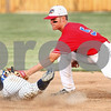 Kyle Bursaw – kbursaw@daily-chronicle.com<br /> <br /> DeKalb County Liners player Andy Lennington tags out a Dubois County Bombers' Grant Zawadzki sliding into second base at Sycamore Park on Wednesday, July 6, 2011.