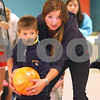 Kyle Bursaw – kbursaw@daily-chronicle.com<br /> <br /> Taylor Case helps Reese Wesseln with his bowling ball as Camp Maple Leaf bowls at Mardi Gras Lanes in DeKalb, Ill. on Wednesday, June 15, 2011.