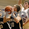 Rob Winner – rwinner@shawmedia.com<br /> <br /> Kaneland's Trever Heinle (10) looks to shoot as Hinckley-Big Rock's Mitch Ruh (22) defends during the first quarter in Hinckley on Tuesday night.