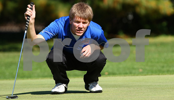 Kyle Bursaw – kbursaw@shawmedia.com<br /> <br /> Genoa-Kingston's Ryan Oplt takes a look at the green before putting on four at Sycamore Golf Club during the IHSA Boys Regional on Tuesday, Oct. 4, 2011.