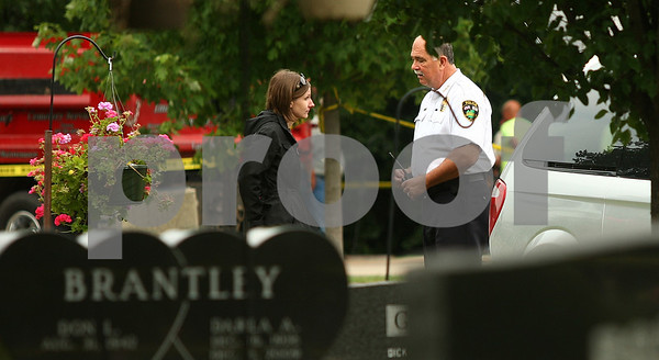 Kyle Bursaw – kbursaw@daily-chronicle.com<br /> <br /> Sycamore Police Chief Don Thomas speaks to a woman at Elmwood Cemetery behind police tape during the exhumation process of Maria Ridulph's body in Sycamore, Ill. on Wednesday, July 27, 2011.