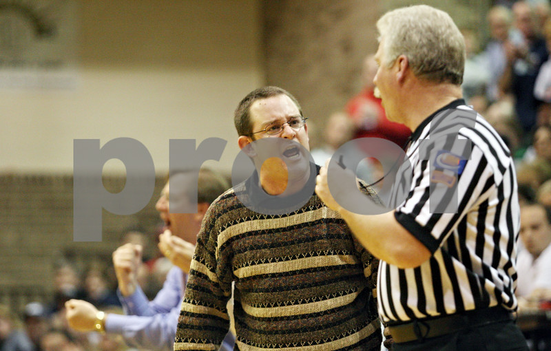 Rob Winner – rwinner@daily-chronicle.com<br /> <br /> Hinckley-Big Rock coach Greg Burks  discusses a call with an official during the fourth quarter of the IHSA Class 1A DeKalb Super-Sectional on Monday February 21, 2011 in DeKalb, Ill.