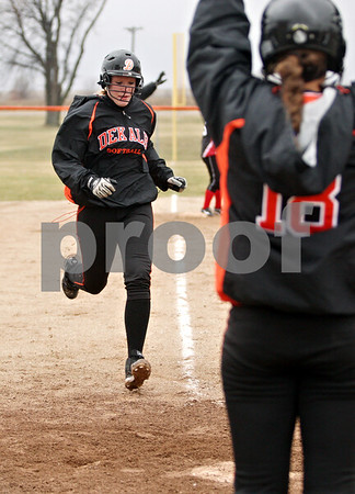 Rob Winner – rwinner@daily-chronicle.com<br /> <br /> DeKalb's Mackenzie Johnson trots home for a run in the bottom of the second inning in DeKalb, Ill., on Wednesday, March 23, 2011. DeKalb went on to defeat Indian Creek in five innings, 16-4.
