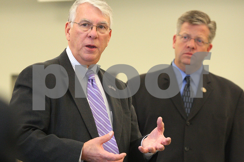 Kyle Bursaw – kbursaw@shawmedia.com<br /> <br /> Congressmen Don Manzullo (left) and Randy Hultgren answer questions during a closed discussion hosted by the DeKalb County Economic Development Corporation at the Farm Bureau in Sycamore, Ill. on Thursday, Nov. 10, 2011.