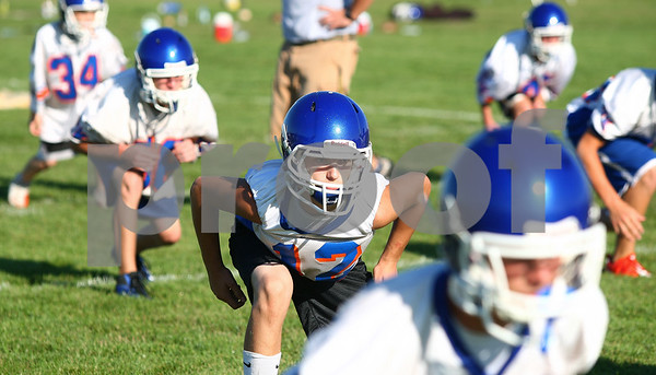 Kyle Bursaw – kbursaw@daily-chronicle.com<br /> <br /> Jesse Bade (center) and other Genoa-Kingston players do a stance drill during practice on Thursday, Aug. 11, 2011.