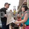 "Curtis Clegg - cclegg@shawsuburban.com<br /> <br /> Self-proclaimed ""libertarian activist"" Ted McCarron of DeKalb (left) and Nichole Eidsmoe of DeKalb get into a heated discussion about the legalities of breast feeding in public places in front of the No Strings Attached resale shop in DeKalb on Thursday, June 2, 2011. Eidsmoe claims she was asked not to breast feed her daughter in the shop on Tuesday."