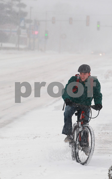 Kyle Bursaw – kbursaw@daily-chronicle.com<br /> <br /> Jason Pittenger, an NIU student, bikes down Lincoln Highway on Tuesday, Feb. 1, 2011.