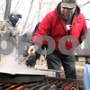 Kyle Bursaw – kbursaw@daily-chronicle.com<br /> <br /> Gary Thomas reduces sap into maple syrup as Connor Lord (left) and Brian Mellema (right) look on. Thomas made the maple syrup at the Natural Resource Center in the Russell Woods Forest Preserve in Genoa, Ill. for the Russell Woods Maple Syrup Fest on Saturday, March 5, 2011.