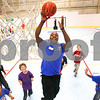 Kyle Bursaw – kbursaw@daily-chronicle.com<br /> <br /> Kishwaukee YMCA intern Dontrel Whitfield goes for a layup during a quick round 'everybody versus the coach' between shooting drills and other games at the Kishwaukee Family YMCA summer day camp on Friday, June 10, 2011.