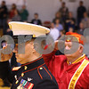 Kyle Bursaw – kbursaw@shawmedia.com<br /> <br /> Staff Sergeant Chase Kovarik and veteran Bill Meyer salute as the Hinckley-Big Rock band plays the national anthem at the conclusion of the ceremony honoring veterans before the girls basketball game on Monday, Dec. 5, 2011.