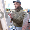 Kyle Bursaw – kbursaw@daily-chronicle.com<br /> <br /> Suren Nersisyan, an international NIU student from Armenia, paints downtown DeKalb from the corner of Second street and Lincoln Highway on Friday, March 11, 2011.