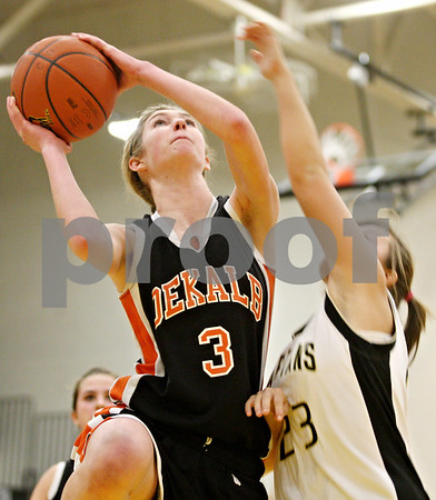 Rob Winner – rwinner@daily-chronicle.com<br /> <br /> DeKalb's Courtney Bemis (3) is fouled by Sycamore's Ashley LeClair during the fourth quarter on Thursday, Feb. 10, 2011 in Sycamore, Ill. Sycamore went on to defeat DeKalb, 34-30.