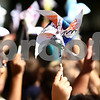 Kyle Bursaw – kbursaw@shawmedia.com<br /> <br /> Sycamore West Elementary students hold up their pinwheels to catch a breeze before planting them in front of the school for a 'Pinwheels for Peace' project in Sycamore, Ill. on Wednesday, Sept. 21, 2011.