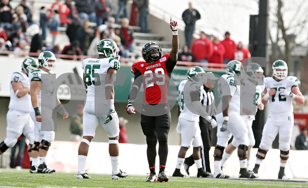 Rob Winner – rwinner@shawmedia.com<br /> <br /> Northern Illinois linebacker Jordan Delegal (29) points to the sky after a sack of Eastern Michigan quarterback Alex Gillett for a 15-yard loss by defensive end Alan Baxter late during the fourth quarter in DeKalb, Ill., on Friday, Nov. 25, 2011. Northern Illinois defeated Eastern Michigan, 18-12.