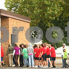 Kyle Bursaw – kbursaw@shawmedia.com<br /> <br /> Indian Creek Middle School students and staff re-enter the school after evacuating due to a gas leak at the nearby Monsanto facility in Waterman, Ill. on Tuesday, Sept. 27, 2011.