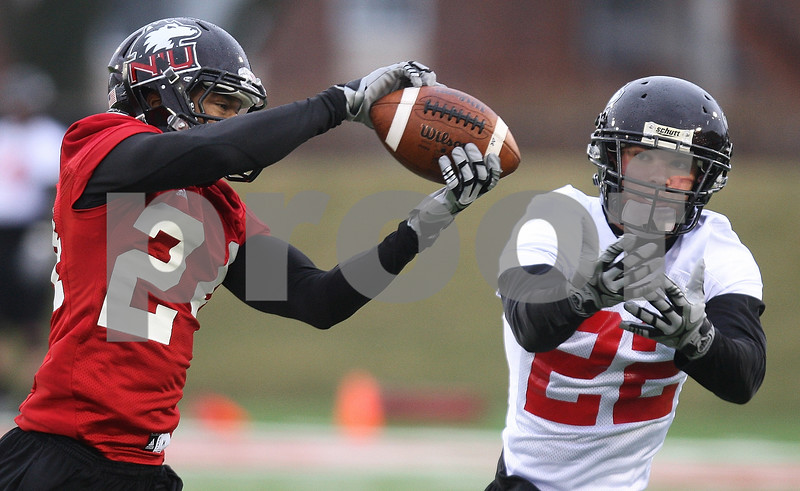 Kyle Bursaw – kbursaw@daily-chronicle.com<br /> <br /> Dominique Ware (24) intercepts a pass intended for Leighton Settle (22) during practice at Huskie Stadium on Tuesday, March 22, 2011.