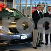 "Jeff Engelhardt –jengelhardt@shawmedia.com<br /> <br /> Toyota sales manager Joe Van Wagner hands Feed'em Soup President David Lumpkin a ""key"" to the charity organization's free Sienna Thursday at Brian Bemis Toyota. The group won the vehicle as part of Toyota's 100 Cars for Good program."