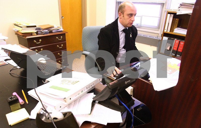 Kyle Bursaw – kbursaw@daily-chronicle.com<br /> <br /> Kakhaberi Gvantseladze works on a tourism project in his office in DeKalb city hall on Tuesday, April 12, 2011. Gvantselasze is in DeKalb as part of the Legislative Fellows program, coming from Kutaisi in the Republic of Georgia.