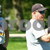 Kyle Bursaw – kbursaw@daily-chronicle.com<br /> <br /> Hiawatha Hawks head coach Sean Donnelly talks to his players in between running offensive plays during morning football practice on Thursday, Aug. 11, 2011.