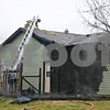 ANDREW MITCHELL — amitchell@shawmedia.com<br /> Sycamore firefighters work to vent the roof of a house in the 1400 block of Larson Street Friday. The south exterior of the house caught fire before 2 p.m. Friday. No one was injured.