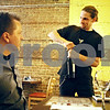 Rob Winner – rwinner@daily-chronicle.com<br /> <br /> Server James Page (right) opens a bottle of wine for Phil Pearson at Mediterraneo in DeKalb on Friday, June 17, 2011. Mediterraneo has had a bring your own bottle license for about a year now.
