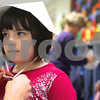 Kyle Bursaw – kbursaw@shawmedia.com<br /> <br /> Danielle Clements ties a paper bonnet on Bella Rieff before the kindergarten's Thanksgiving feast at Davenport Elementary School in Genoa, Ill. on Tuesday, Nov. 22, 2011.