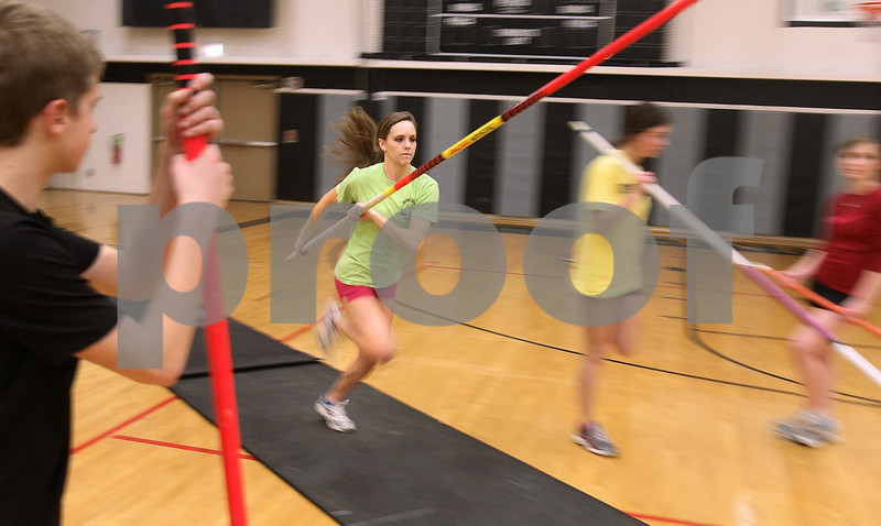 Kyle Bursaw – kbursaw@daily-chronicle.com<br /> <br /> Kaneland's Brooke Patterson practices the pole vault in a school gym on Wednesday, March 9, 2011.
