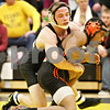 Rob Winner – rwinner@daily-chronicle.com<br /> <br /> Sycamore's Austin Culton (left) goes against DeKalb's Mitchell Todd in the 140-pound match on Thursday, Jan. 13, 2011 in Sycamore, Ill. Culton would go on to win the match for Sycamore.