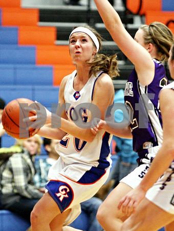 Rob Winner – rwinner@daily-chronicle.com<br /> <br /> Genoa-Kingston center Kelsie Campbell looks to shoot during the second quarter in Genoa, Ill. on Tuesday, Jan. 4, 2011.