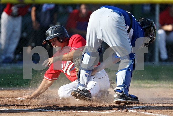 Rob Winner – rwinner@daily-chronicle.com<br /> <br /> On Wednesday evening in Sycamore, DeKalb County's Steven Scoby (left) is tagged out at the plate by Terre Haute catcher Shane Blair during the fourth inning of a resumed game that was suspended due to rain on Tuesday. The Liners lost to Terre Haute, 13-11.