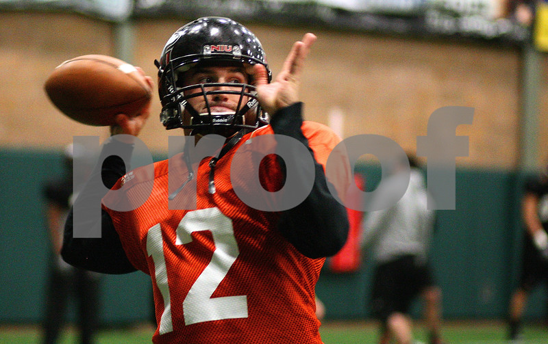 Kyle Bursaw – kbursaw@shawmedia.com<br /> <br /> Northern Illinois quarterback Chandler Harnish throws a pass during practice at the DeKalb Recreation Center on Wednesday, Dec. 14, 2011.