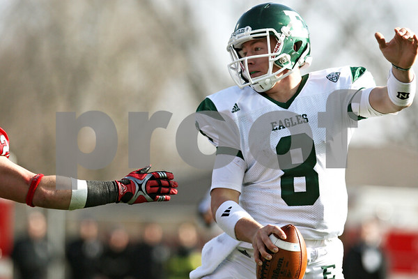 Rob Winner – rwinner@shawmedia.com<br /> <br /> Eastern Michigan quarterback 	Alex Gillett (8) eludes the grasp of Northern Illinois linebacker Pat Schiller during the fourth quarter in DeKalb, Ill., on Friday, Nov. 25, 2011. Northern Illinois defeated Eastern Michigan, 18-12.