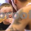 Kyle Bursaw – kbursaw@daily-chronicle.com<br /> <br /> Connor Riccardi, 5, snacks on a hot dog while talking talking to Joe Riccardi at Riccardi's Red Hots & Soda Fountain in Sycamore, Ill. on Friday, May 13, 2011.