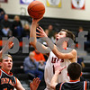Kyle Bursaw – kbursaw@shawmedia.com<br /> <br /> DeKalb guard Brian Sisler shoots between Winnebago players Dalton Menke (left) and Taylor Shumate (right) <br /> during the second half of the game in the Chuck Dayton Holiday Tournament in DeKalb, Ill. on Thursday, Dec. 22, 2011. DeKalb defeated Winnebago 46-36.