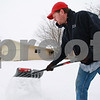 Kyle Bursaw – kbursaw@daily-chronicle.com<br /> <br /> Shawn Dodson shovels the sidewalk in front of his home in Sycamore, Ill. on Tuesday, Jan. 11, 2011.