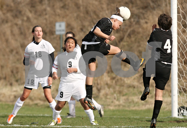 Rob Winner – rwinner@daily-chronicle.com<br /> <br /> Sycamore's Michelle Doran scores her second goal of the game with a header during the first half in Maple Park, Ill., on Wednesday, April 6, 2011. Sycamore defeated Kaneland, 4-1.