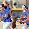 Rob Winner – rwinner@daily-chronicle.com<br /> <br /> Genoa-Kingston second baseman Erica Anderson (4) runs toward the dugout with her teammates after catching a fly ball during the bottom of the first inning in Shabbona, Ill., on Wednesday, March 16, 2011. Genoa-Kingston defeated Indian Creek, 26-1.