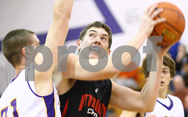Kyle Bursaw – kbursaw@shawmedia.com<br /> <br /> Indian Creek's Andrew Hall goes for a shot against the defense of Mendota's Trae Blumhorst during the first quarter of their game during the Plano Christmas Classic Tournament in Plano, Ill. on Monday, Dec. 26, 2011.
