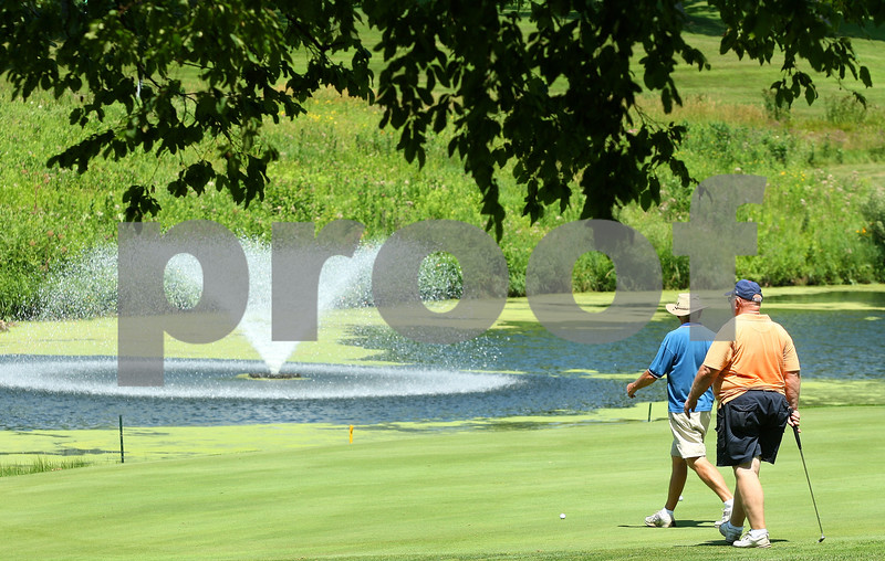 Kyle Bursaw – kbursaw@daily-chronicle.com<br /> <br /> A pair of golfers walk onto the green at the sixth hole of Indian Oaks Country Club in Shabbona, Ill. on Tuesday, July 12, 2011.