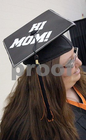 Wendy Kemp - For The Daily Chronicle<br /> <br /> Graduate Sarah Johnson shows off the message to her mom before the DeKalb High School graduation ceremony at the Convocation Center at Northern Illinois University on Saturday.