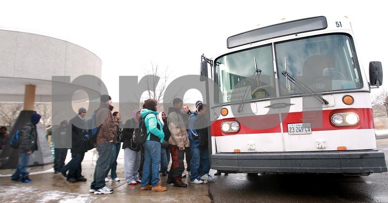 Kyle Bursaw – kbursaw@daily-chronicle.com<br /> <br /> Kishwaukee College students load the 1pm TransVAC bus headed toward DeKalb on Wednesday, Jan. 12, 2011.