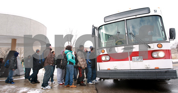 Kyle Bursaw – kbursaw@daily-chronicle.com<br /> <br /> Kishwaukee College students load the 1pm TransVAC bus headed toward DeKalb on Wednesday, Jan. 12, 2011.