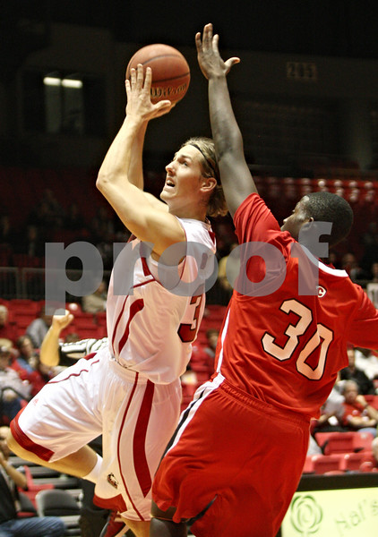 Rob Winner – rwinner@shawmedia.com<br /> <br /> Aksel Bolin (left) of Northern Illinois is fouled by Carthage guard Marlon Senior (30) during the first half of their game in DeKalb, Ill., on Friday, Nov. 4, 2011.