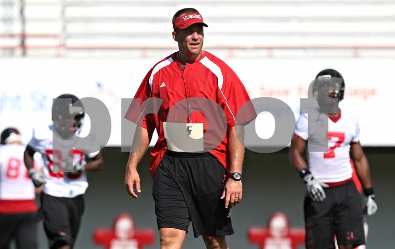 Rob Winner – rwinner@daily-chronicle.com<br /> <br /> Northern Illinois head coach Dave Doeren walks the field during practice at Huskie Stadium in DeKalb on Thursday.