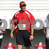 Rob Winner – rwinner@daily-chronicle.com<br /> <br /> Northern Illinois head coach Dave Doeren walks the field during practice at Huskie Stadium in DeKalb on Thursday.