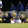 Rob Winner – rwinner@shawmedia.com<br /> <br /> A swarm of Hiawatha defenders tackle Christian Life's Mitch Schorr during the second quarter in Kirkland on Friday, Sept. 16, 2011.