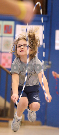 Kyle Bursaw – kbursaw@daily-chronicle.com<br /> <br /> Brooke Patterson tries the forward jump rope technique as teacher Cris Zakosek explains it to the kindergarten class at St.  Mary school as part of Jump Rope for Heart on Wednesday, Feb. 9, 2011.
